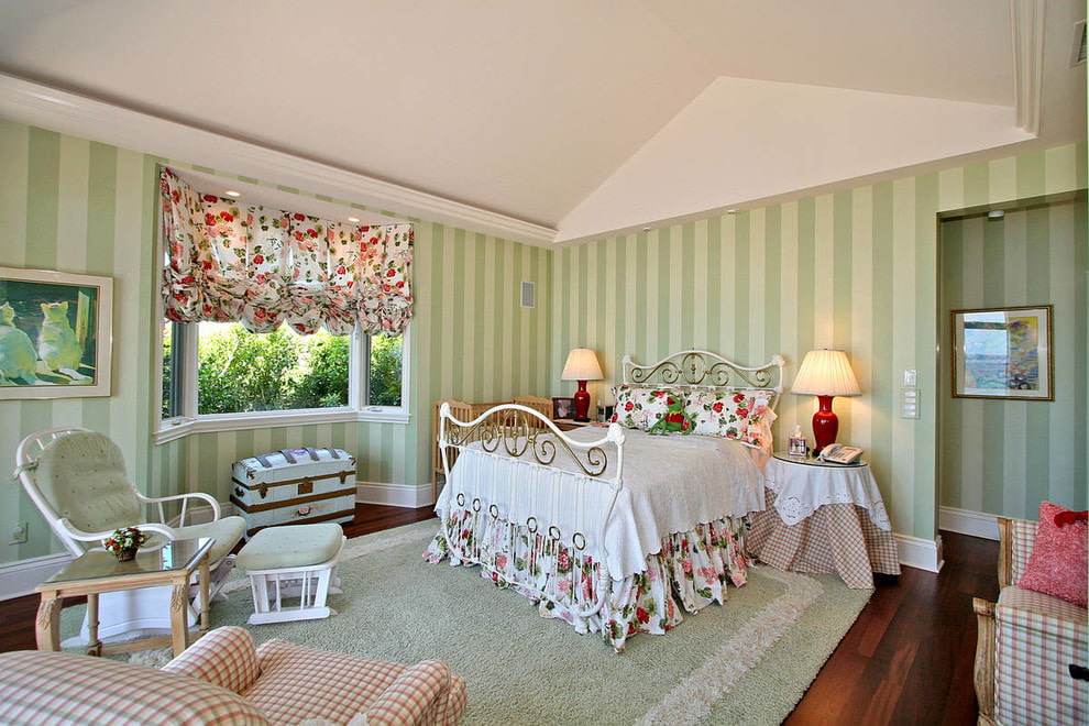 Bedroom with vertical striped green wallpaper.