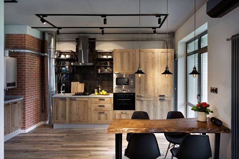 Intérieur de cuisine de style industriel avec chaises noires
