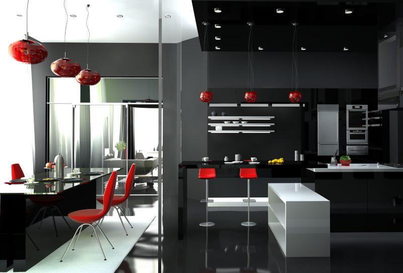 Suspension rouge dans la cuisine noire