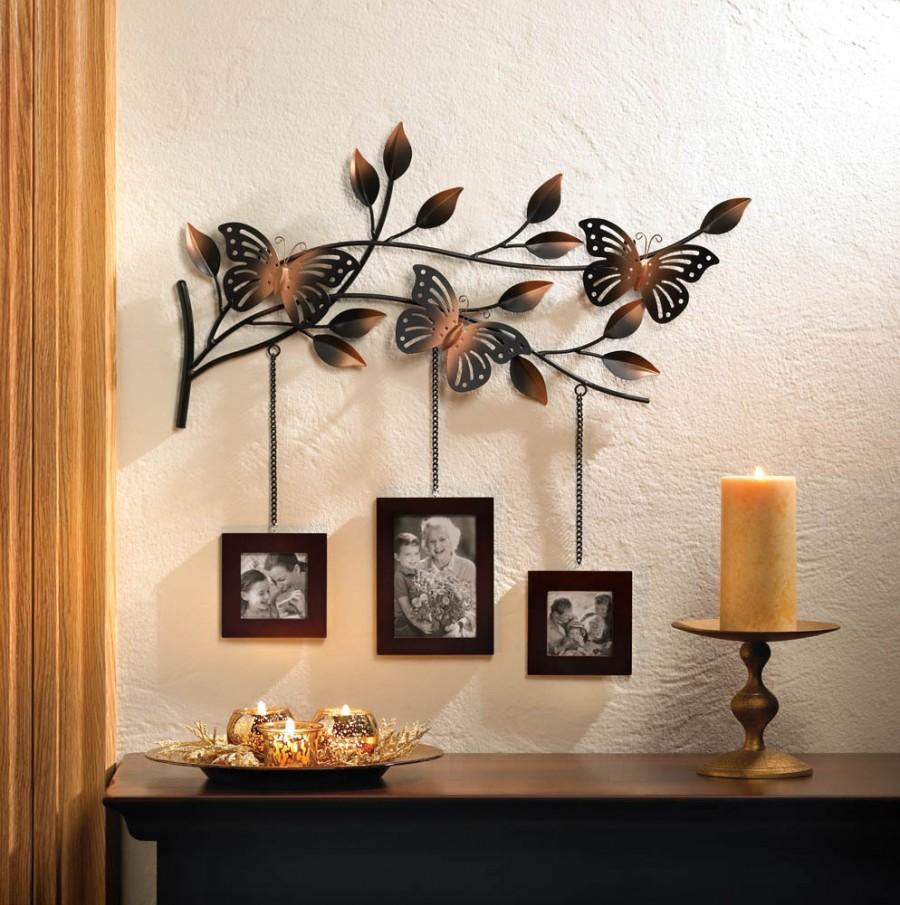 Trīs fotogrāfijas uz dekoratīva zaru kulona
