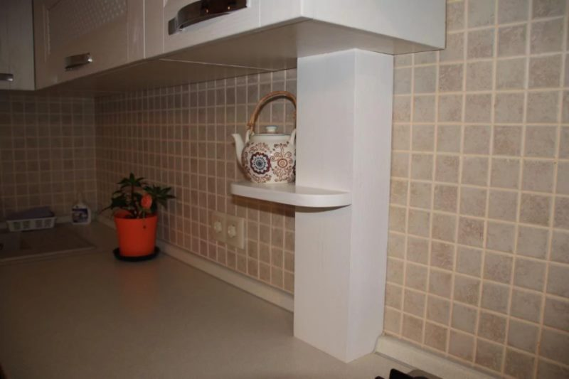 Disguising pipes in the kitchen with a wooden box