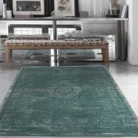 Nobružāts zaļganais paklājs