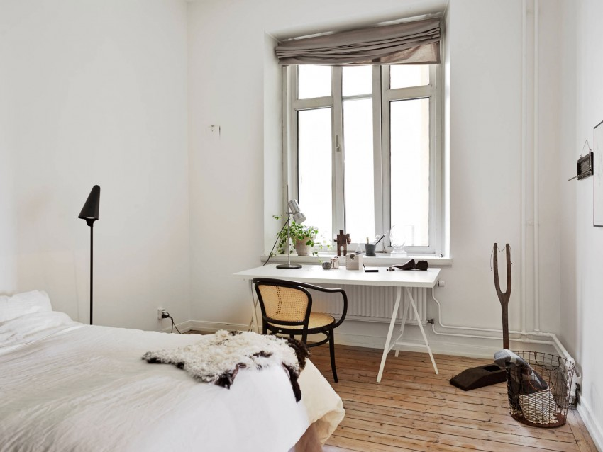 White heating pipes in a Scandinavian style bedroom