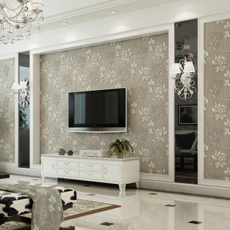 Черен телевизор на стената с бежов тапет
