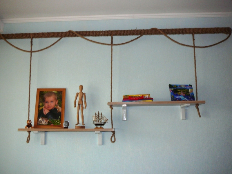 Shelves for souvenirs on the heating pipe