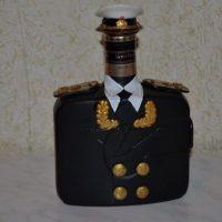 Pudele tunikā dāvanai vīrietim