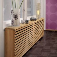 Masking the heating system with wooden slats