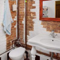 Copper pipes in a loft style bathroom