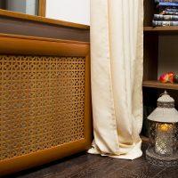 Beige curtain near the wooden screen