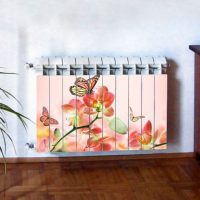 Butterflies with flowers on a heating radiator