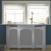 White heating screen box on a blue wall