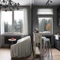 Cuisine-salon avec un canapé au milieu
