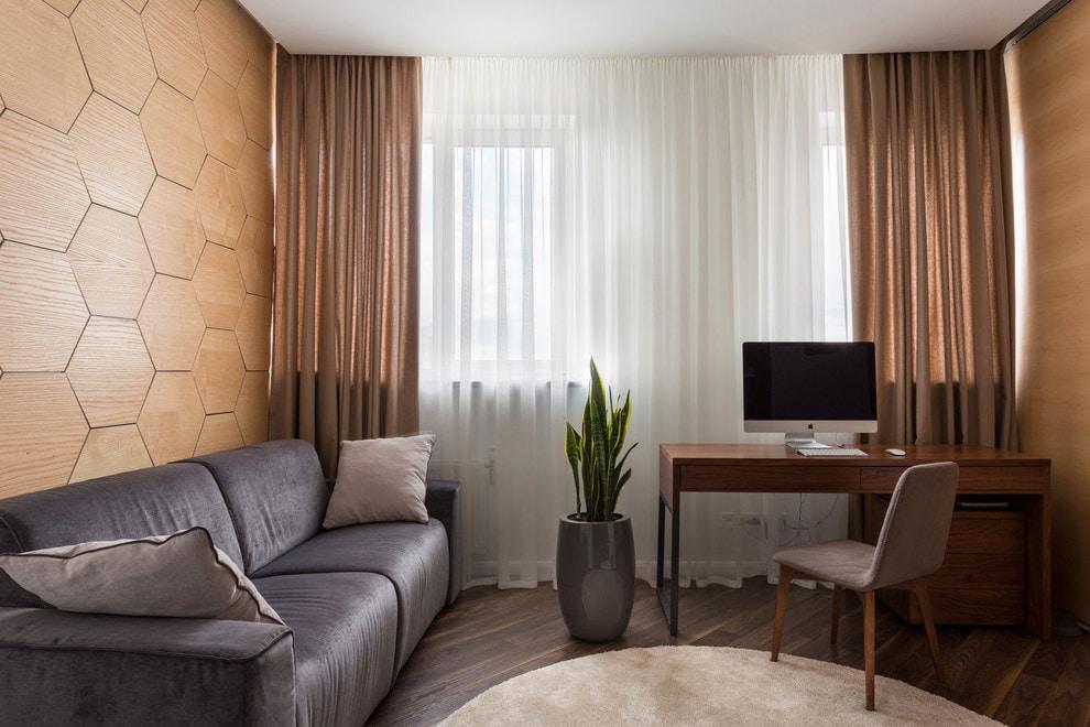 Rideaux marron translucides dans le salon d'un appartement moderne