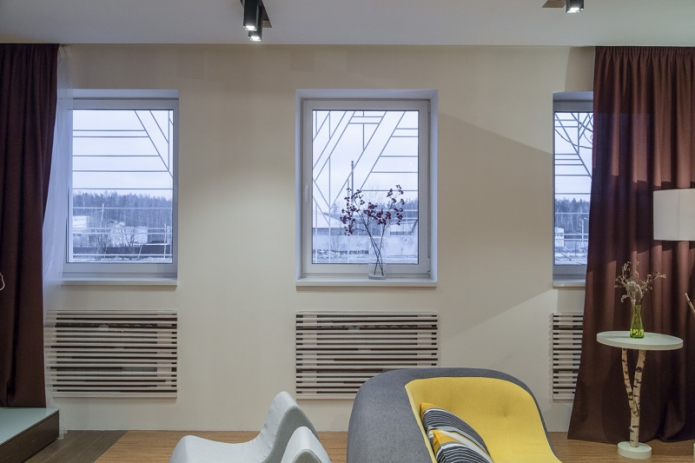 Rack-mounted heating screens in the living room of a private house