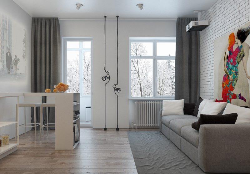 Cuisine-salon intérieur avec porte de balcon