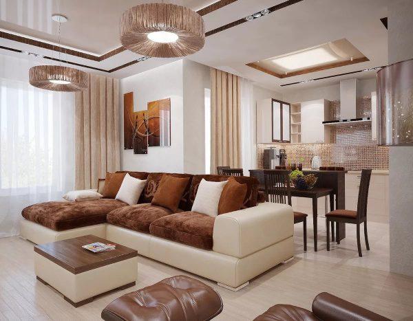 Cela peut être fait en choisissant un lustre central pour le salon, une suspension pour la salle à manger et des projecteurs pour la salle de travail.