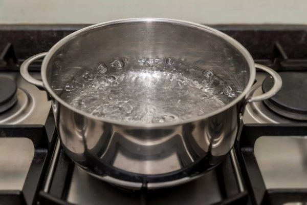 Heat a pot of water to a boil, put in the freezer section, close the door.
